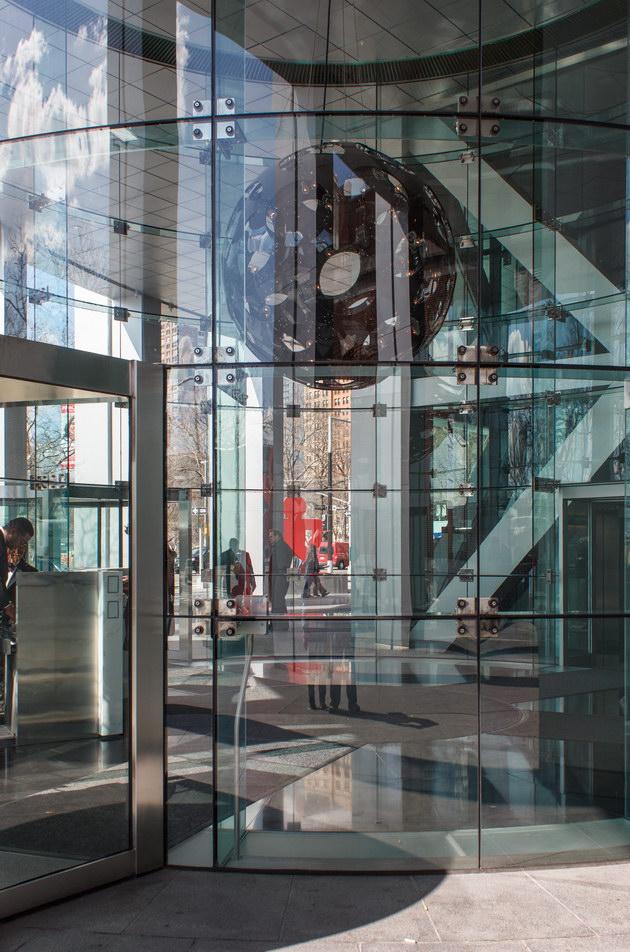 Circular glass-enclosed lobby.
