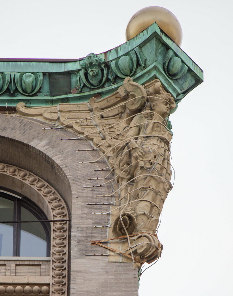 Two terra cotta angels support the cornice on the Nassau Street facade - helped by lots of iron straps.