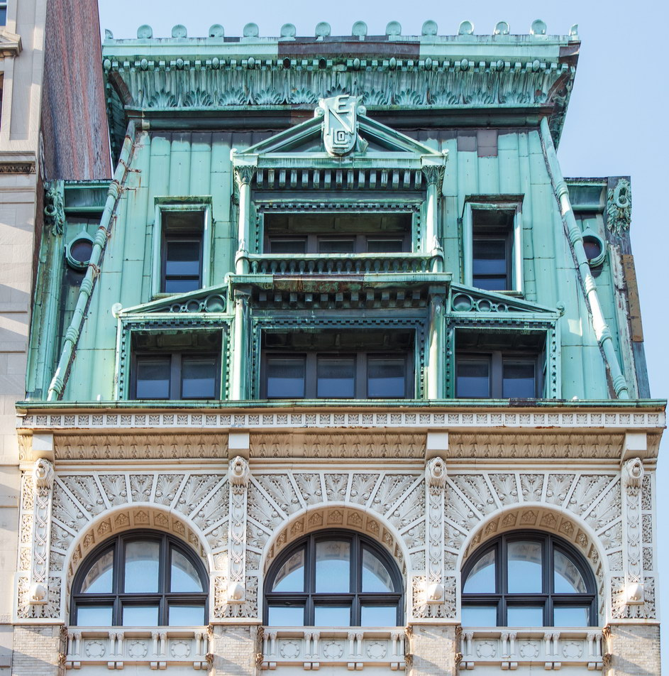 The massive copper mansard roof is easy to spot from a block away.