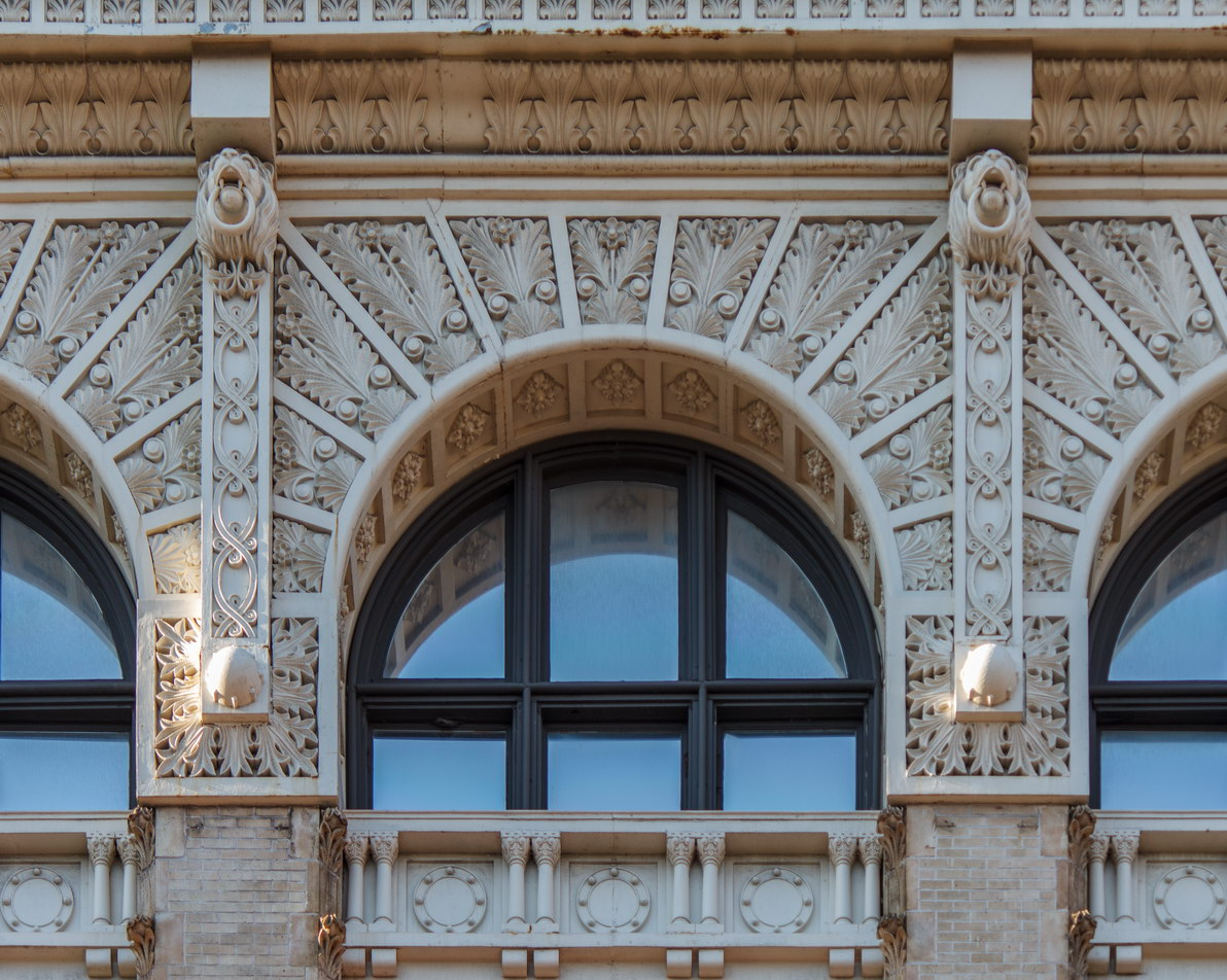 Rich terra cotta sixth floor looks almost like carved ivory.