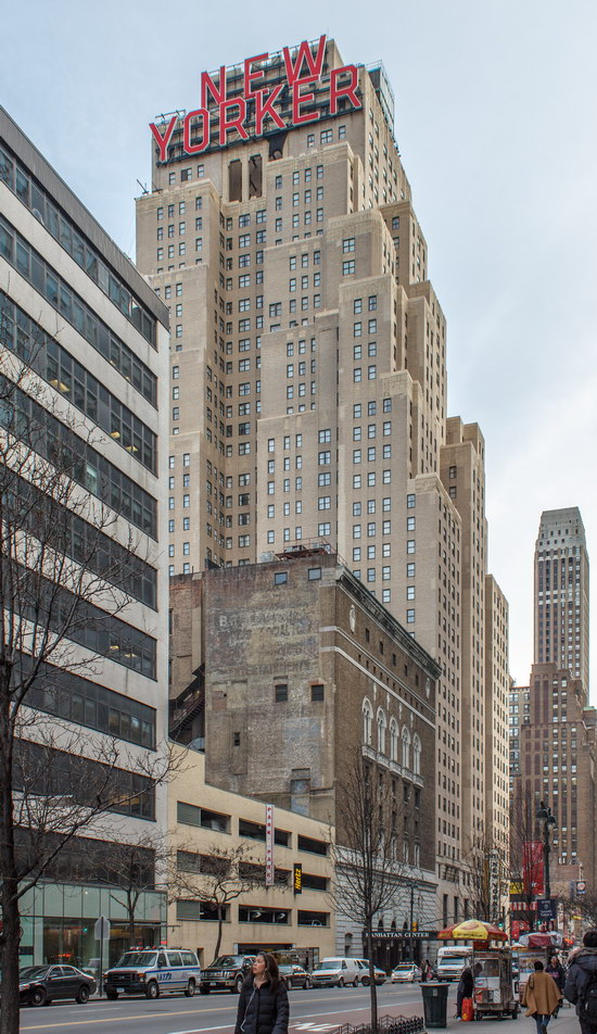 """The four-story """"NEW YORKER"""" sign is the building's most prominent feature."""