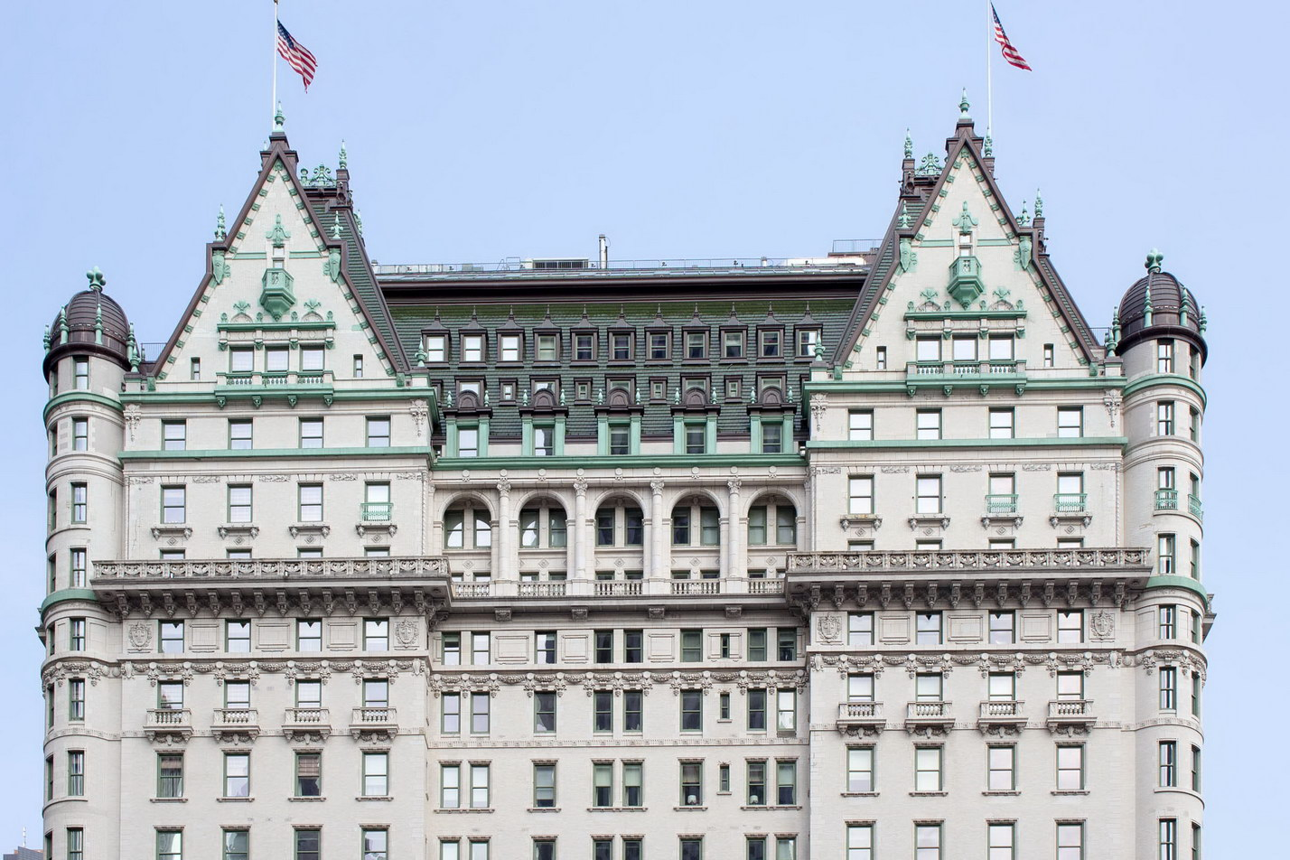 A fantastic mansard roof crowns Plaza Hotel, underscored by tiers of balustrades and terra cotta.