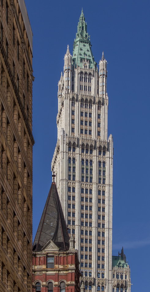 Color in the spandrels (decorative panels above/below each window) enhance the tower's vertical lines.