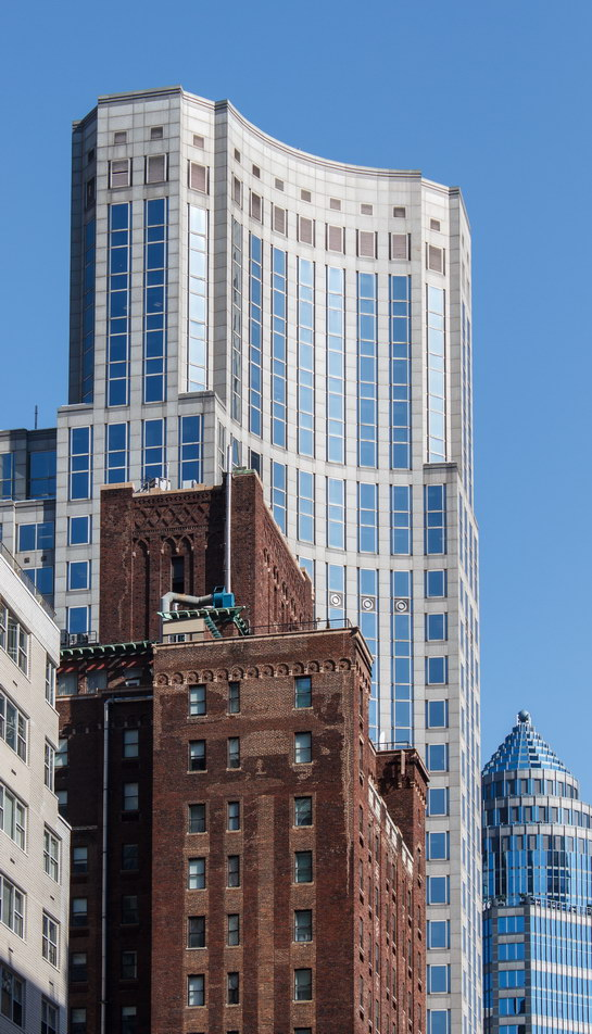 The distinctive concave face towers over the intersection of E 57th Street and Lexington Avenue.