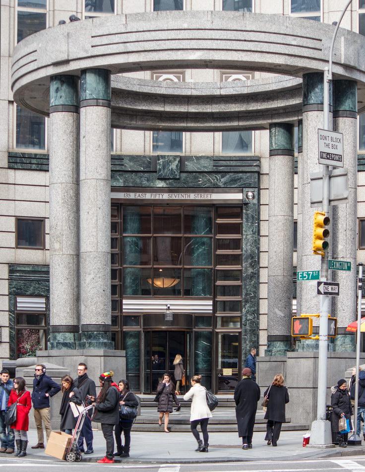 "Circular ""temple"" dominates the corner plaza."