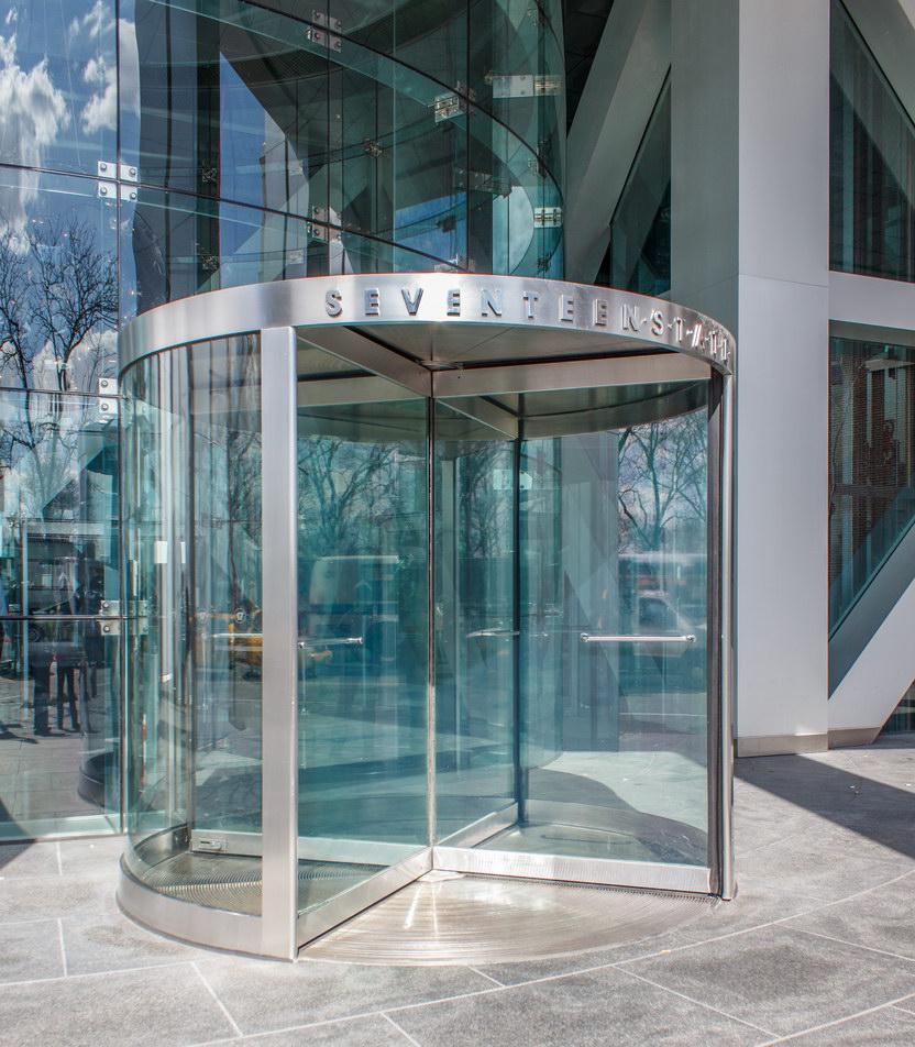 Glass-enclosed entry to the glass-enclosed lobby.