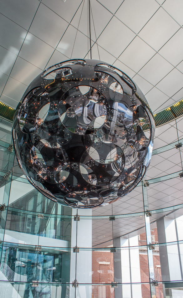 A black glass sphere chandelier dominates the lobby.