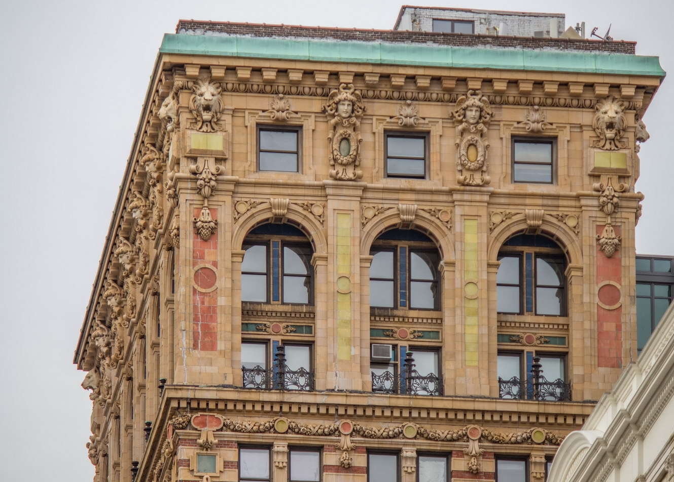 The building's crown is of colorful terra cotta.