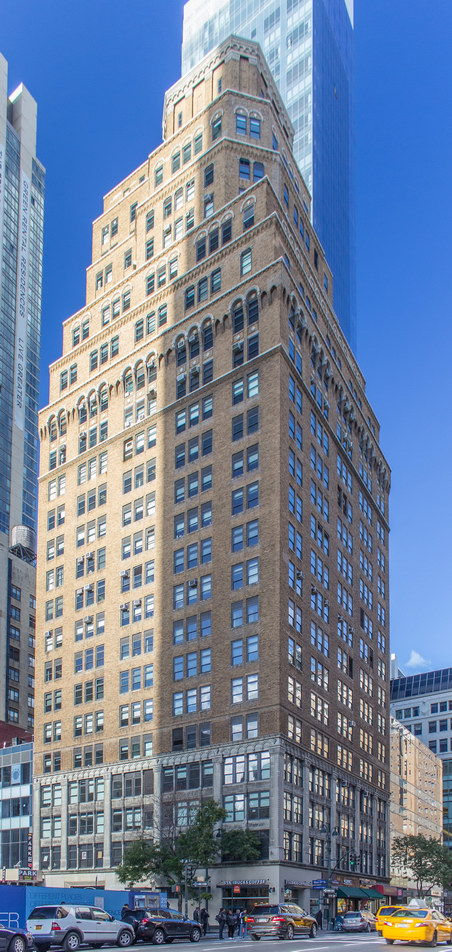 The Greeley Square Building stands one block south of Greeley Square.