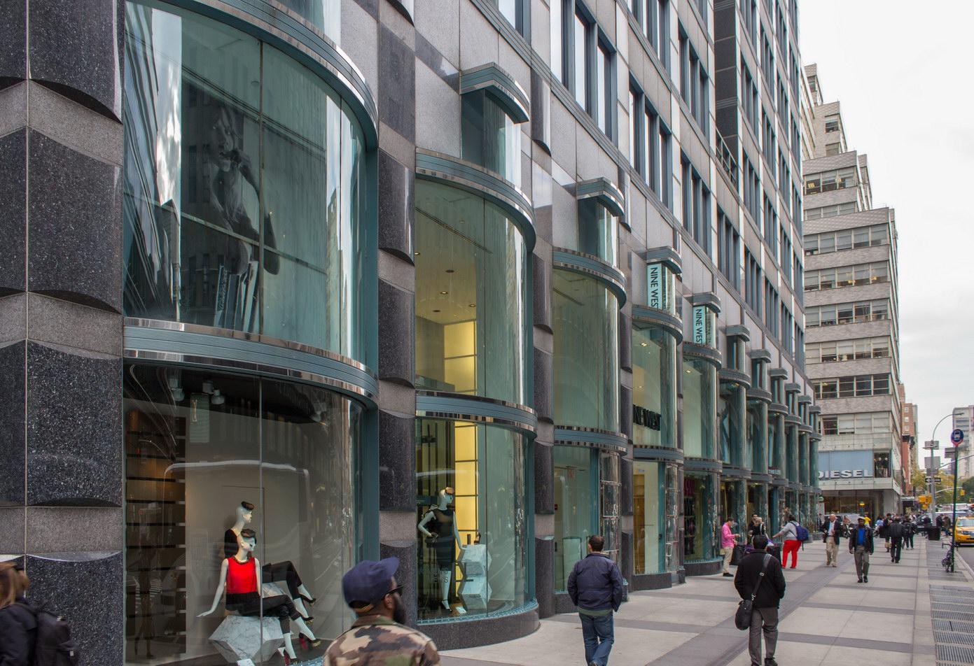 Bowed double-height storefronts face Lexington Avenue.