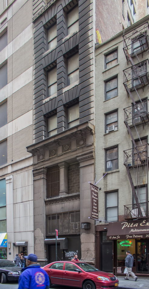 The narrow Ann Street facade includes a freight entrance.
