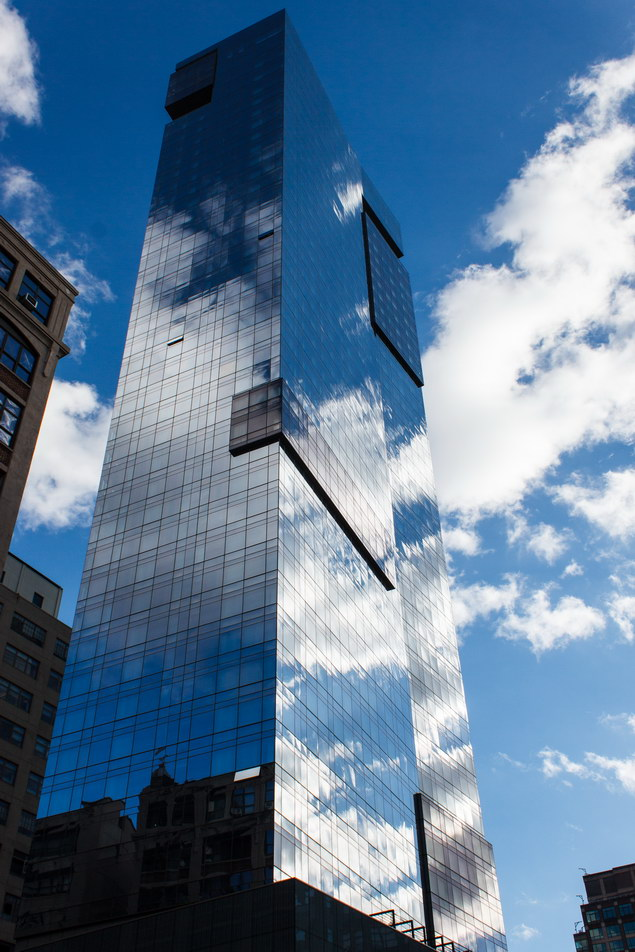 Interesting play of clouds and sky against the mirror facade.