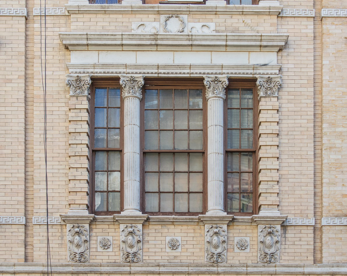 A second-story window with columns and pilasters