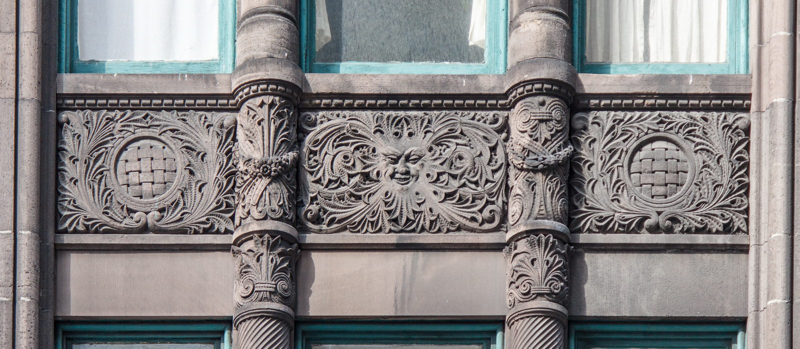 Wider spandrels on Fifth Avenue facade.